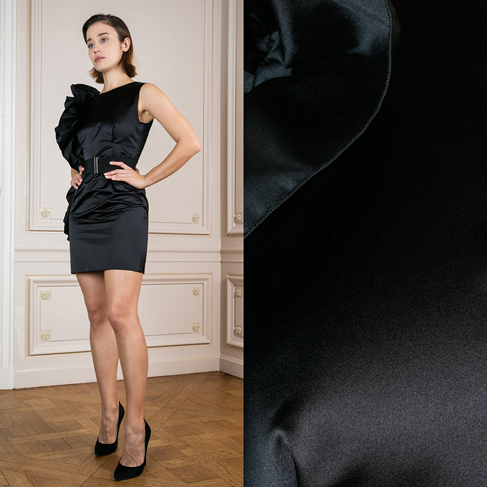 Mini black dress with a statement right shoulder
